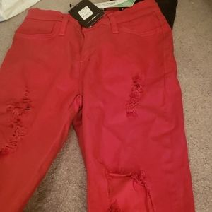 Red ripped pants